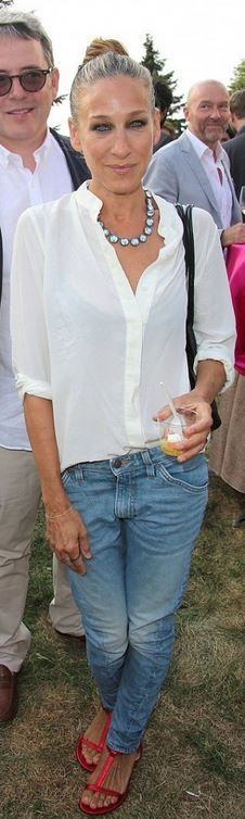 Sarah Jessica Parker's red flat sandals blue jeans, jewelry.