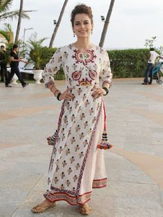 Kangna Ranaut: This colourful ethnic printed suit by Vrisa is a perfect choice for summer. Kangna looks super fresh and elegant in this style.
