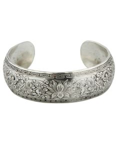Silvertone metal lotus flower cuff bracelet symbolizes spiritual enlightenment. Lotus flower jewelry available at BuddhaGroove.com.