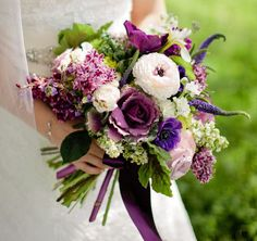 Well-balanced purple bouquet with Brassica • Syringa • Ranunculus • Veronica • Anemone