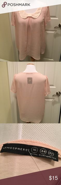 NWT Pretty Pink Sheer Blouse From Ireland 🇮🇪 NWT Pretty, short sleeved sheer blouse with cream, bow-look collar & slight front pleat.  Purchased in Ireland.  Wear over a camisole.  Perfect for spring and summer!  Nonsmoking house. Atmosphere Tops Blouses