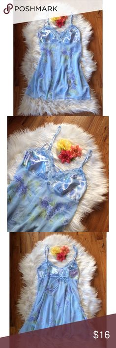 Vintage 90's Floral Silk Slip Dress 💐 Beautiful vintage 90's slip dress! Soft light blue color with a gorgeous blue floral pattern. Semi-sheer soft and flowy bodice with silky cups and double strap detail. Ties in the back for an adjustable fit! Pair with a white tee or turtleneck dress underneath for a super cute outfit or wear to bed at night! In great vintage condition. One of a kind piece! Not AA! Size medium but can also work for a size small :) American Apparel Intimates & Sleepwear…