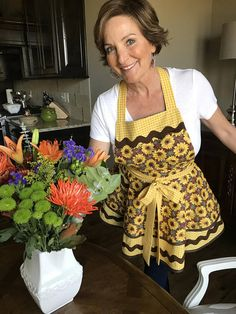 Fall Sunflowers Women's Retro Kitchen Apron with Yellow Gingham, a touch of the Midwest and a great way to protect your clothes while cooking. Apron by Creative Chics