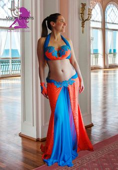 Stunning modern belly dance costume, orange glitter lycra with turquoise insets. Decorated with glass stones. Order online: http://www.makaridreams.com/