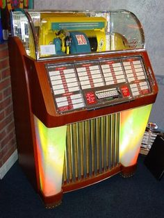1957 Jukebox-I love the Jukebox with all the old songs.My daughters rented one for my birthday which had a theme. So much fun. Jukebox, Green Label, Retro, Radios, Radio Antigua, Music Machine, American Diner, Soda Fountain, Record Players