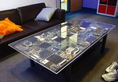 I love this idea of a circuit board table. The plan: to make a circuit board desk that lights up for my son.