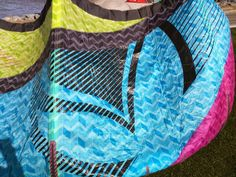 Liquid Force Envy 2014/2015 kitesurfing kite. Turquoise, yellow and pink.