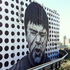 JR New Mural In New York City, two days in the pasting.