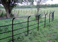 Traditional wrought iron stud estate fencing with curved top rail. Garden Railings, Gates And Railings, Garden Fencing, Iron Railings, Field Fence, Farm Fence, Dog Fence, Driveway Entrance, Entrance Gates