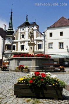 Grein, Austria (there's a most charming little theater there from the 1700s, with performances authentic to the style of the time)