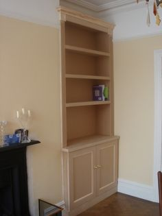 Reeded / fluted architraving on the sides, and corner mouldings at the top finish it off.
