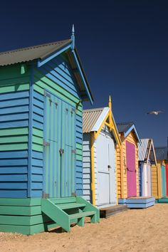 MELBOURNE, AUSTRALIA Along the sand on Brighton Beach is a row of colorful bathing boxes that do their best job stealing the attention away from the blue ocean. Each one was personally decorated by the owner, so they boast an assortment of colors and styles.