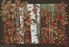 Nancy Zieman shares tips and techniques of landscape quilting, creating fall scenes.