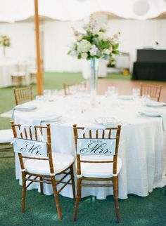 Fun wedding reception chair signs for the bride and groom {Photo by Michael & Carina Photography via Project Wedding}