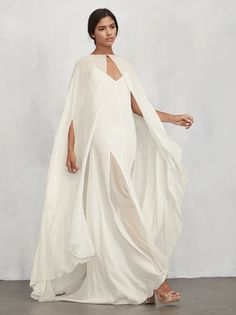 Get married in a full length cape if you want to. The Doris Cape is a chic, sheer georgette cape with a hook/eye closure at the neck. It tapers down the front and there are arm openings at the side so it's easy to slip into and out of. Wear it at the ceremony to look a bit more formal, then lose it at the reception to show a bit more skin. Made from 100% viscose.