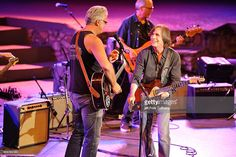 Actor Tim Robbins (C) and rock musician Jackson Browne (R) perform at the Jail Guitar Doors All-Star Fundraising Concert at Ford Theatre on September 5, 2014 in Hollywood, California.