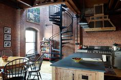 such a good loft kitchen - though I hope he doesn't splatter the bricks with bacon fat - desiretoinspire.net -