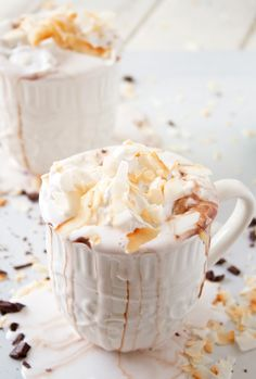 Coconut Hot Chocolate with Coconut Whipped Cream. Sounds amazing. I love coconut!