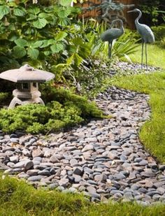 Japanese - inspired garden with rock riverbeds beds for rainwater runoff