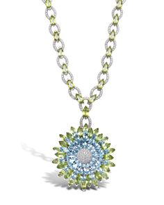 Created in the Asprey workshops, the Double Daisy Necklace has marquise cut blue topaz, peridot and pavé brilliant cut diamonds, set in 18ct white gold