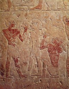Two sculptors working on a statue – Saqqara (5th Dynasty: c. 2510-2460 BC) painted stone relief. Cairo, Egyptian Museum
