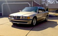 Restored 1998 BMW 740i with new chrome front grilles.  Black wrapped roof.
