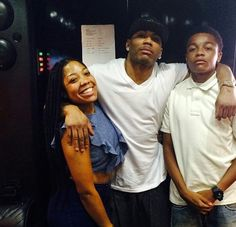 Nelly with his daughter and son