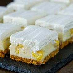 Pineapple Squares - an old no-bake Newfoundland Cookie Bar reinvented! An old time, no-bake Newfoundland Cookie Bar recipe thats been updated with a bit of a reinvention and a new flavour addition. Source by RockRecipes Barres Dessert, Pineapple Squares, Newfoundland Recipes, Pineapple Desserts, Pineapple Frosting, Pineapple Cookies, Rock Recipes, Bar Recipes, Cream Recipes