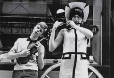Posing with an unnamed model for Boyfriend magazine, Kingly Street, London, 1963. Photo: Redferns