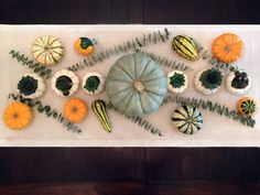 Fall or Halloween Tablescape With Pumpkins and Succulents >> http://blog.diynetwork.com/maderemade/2013/10/02/plant-succulents-in-pumpkins-for-a-modern-fall-tablescape?soc=pinterest