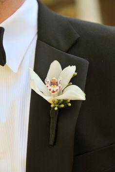 beautiful orchid boutonniere.