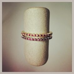Ruby pave eternal bands, shown in 14k yellow gold and in 14k white gold. DVVS Fine Jewelry #julybirthstone #ruby