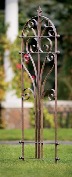 I'd like to have one of these on each side of my windows versus shutters! Italian Iron Trellis arbors-to-trellises.com