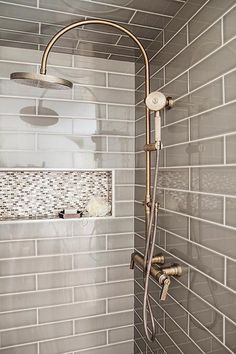 GRAY SHOWER TILE-Gray walk in shower boasts ceiling and walls clad in gray tiles fitted with a white and gray mosaic tiled shower niche as well as a vintage style exposed plumbing shower kit. Tile Shower Niche, Mosaic Shower Tile, Gray Shower Tile, Gray Tiles, Bathroom Gray, Bathroom Closet, Shower Ceiling Tile, Modern Bathroom, Small Tile Shower