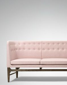 Mayor Sofa by Arne Jacobsen...love the blush upholstery and what looks like an ash or walnut frame