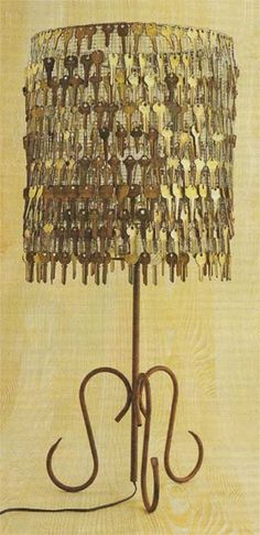Old keys give this lamp shade da' steampunky look! That's a lot of old keys, wonder if I could find enough. :)