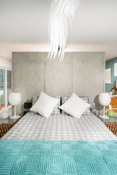 Master bedroom in a contemporary addition in a Mid-century home. Neutral grays and whites with pops of lime green and turquoise. Icarus light adds whimsy to this calm space. Photo Credit CJ South Modern & Contemporary Bedroom Design
