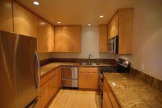 Contemporary Kitchen with Moda Vertical Cabinet Door, DishDrawer Double Dishwasher, Giallo Veneziano Granite, Stonemark