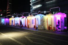 """Glowing water tanks by Urbantainer invite passers-by to take a look at works of art in Seoul, Korea.  """" We captured the hopes and dreams in an abandoned water tank.""""  Korean architecture and design firm Urbantainer used large water tanks, commonly found around the city, to display artwork by graduating college students. The containers are usually limited to storing water, but were given a new lease of life as exhibition spaces."""