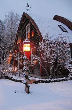Barn Home At Christmas  Love the bow shaped roof.