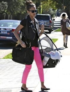Pretty in pink: The stylish actress and businesswoman took baby Haven to a friend's house for a playdate in February