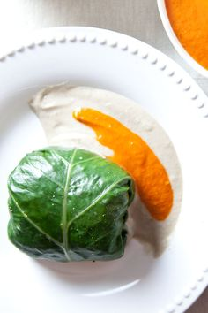 Collard Wraps with Mushrooms & Wild Rice with Garlic Cream and Red Pepper Puree :)