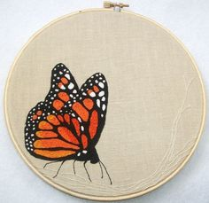 butterfly is made up of 'lots of split stitches, some french knots, and a few back stitches' on reclaimed linen