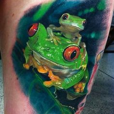 Green frogs Tattoo..  Love the colors