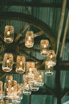 mason jar chandelier. old wooden wheel, lights, masons.