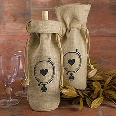 Burlap Wine Bag - Globe with Heart - The Burlap Wine Bag - Globe with Heart is a practical wine bag your guests are sure to love. These bridal party gifts feature a burlap wine bag, with a heart and globe design in black, and twine drawstring closure at top. http://www.favorfavor.com/page/FF/PROD/HBH32580