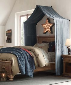 I like this canopy-over-bed idea. Just not digging the star light.