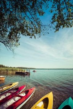Photographic Print: Colorful Kayaks Moored on Lakeshore, Goldopiwo Lake, Mazury, Poland. by Curioso : 24x16in