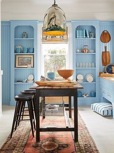 Designed by Sarah Blank, the kitchen was made all the more functional withthe addition of an antique island and contemporary stools by Brownstone.