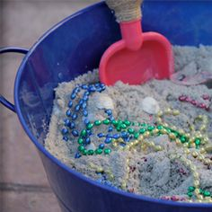 Jake Party Activities - love this idea of digging for treasure in bucket of sand.  Could hide some plastic gold coins, necklaces (as shown), shells, etc.